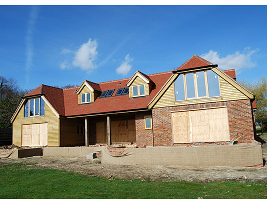 New build in Woodmancote Nr Henfield. Mixed use of natural exterior materials to create a bold look.